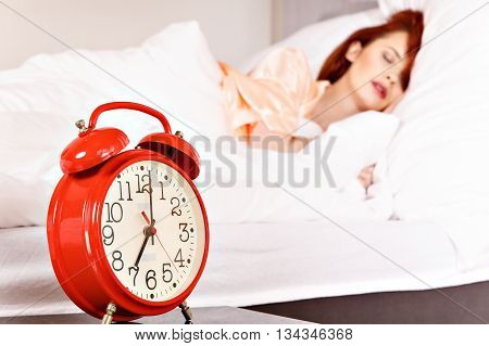Woman Sleeping On The White Bed-clothes In Bed At Home