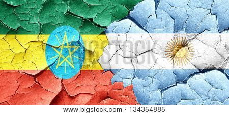 Ethiopia flag with Argentine flag on a grunge cracked wall