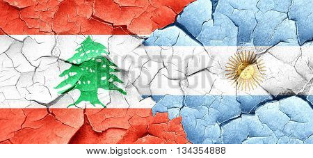Lebanon flag with Argentine flag on a grunge cracked wall