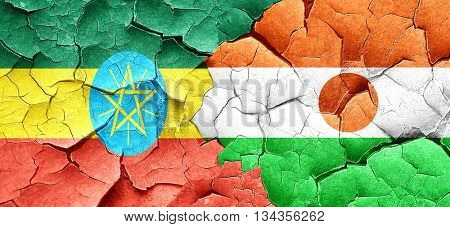 Ethiopia flag with Niger flag on a grunge cracked wall