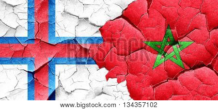 faroe islands flag with Morocco flag on a grunge cracked wall