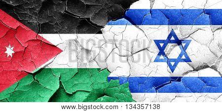 Jordan flag with Israel flag on a grunge cracked wall