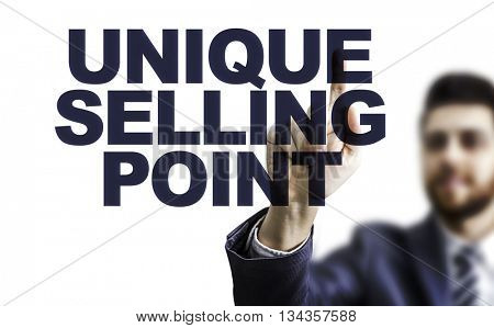 Business man pointing the text: Unique Selling Point