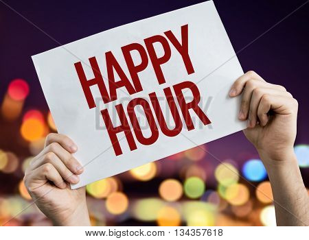 Happy Hour placard with night lights on background