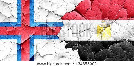 faroe islands flag with egypt flag on a grunge cracked wall