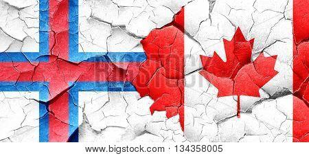 faroe islands flag with Canada flag on a grunge cracked wall