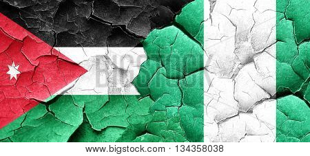 Jordan flag with Nigeria flag on a grunge cracked wall