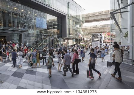 BANGKOK THAILAND - MAY 29 : walking people in open space between Siam Discovery and Siam Center after renovate in siam square on may 29 2016 thailand. siam aquare is one of landmark for tourist in bangkok