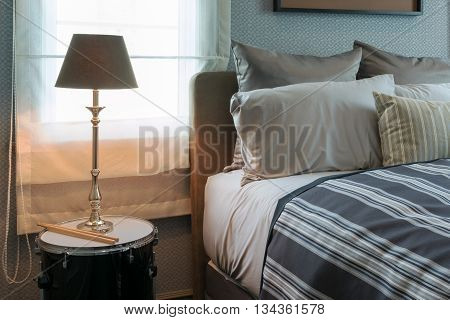 Luxury Lamp On Bedside Table In Stylish Bedroom Interior