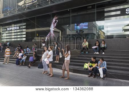 BANGKOK THAILAND - MAY 29 : people waiting for bus at Siam center in siam square on may 29 2016 thailand. siam square is famous shopping place of Bangkok