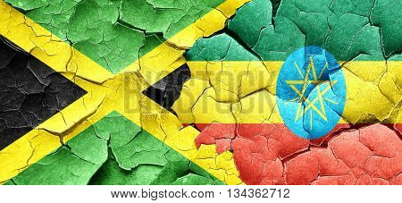 Jamaica flag with Ethiopia flag on a grunge cracked wall