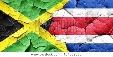 Jamaica flag with Costa Rica flag on a grunge cracked wall