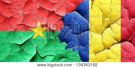Burkina Faso flag with Romania flag on a grunge cracked wall