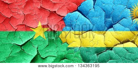 Burkina Faso flag with rwanda flag on a grunge cracked wall