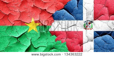 Burkina Faso flag with Dominican Republic flag on a grunge crack