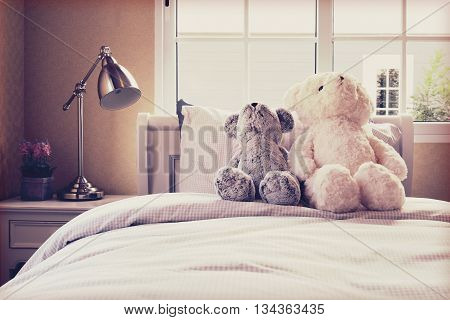 Vintage Photo Of Kids Room With Dolls And Pillows On Bed And Bedside Table Lamp