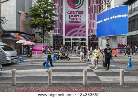 BANGKOK THAILAND - MAY 29 : unidentified people walk across crosswalk at Digital Gateway in siam square on may 29 2016 thailand. siam square is famous shopping place of Bangkok