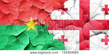 Burkina Faso flag with Georgia flag on a grunge cracked wall
