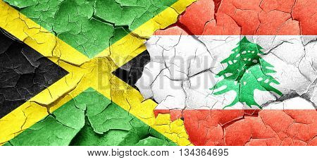 Jamaica flag with Lebanon flag on a grunge cracked wall