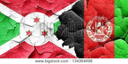 Burundi flag with afghanistan flag on a grunge cracked wall