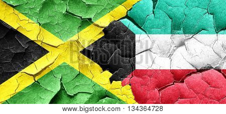 Jamaica flag with Kuwait flag on a grunge cracked wall