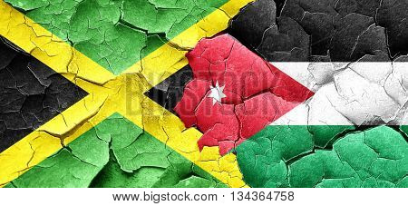 Jamaica flag with Jordan flag on a grunge cracked wall