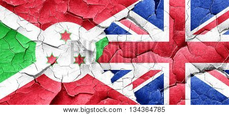 Burundi flag with Great Britain flag on a grunge cracked wall