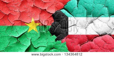 Burkina Faso flag with Kuwait flag on a grunge cracked wall