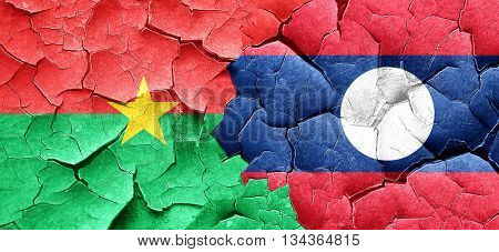 Burkina Faso flag with Laos flag on a grunge cracked wall