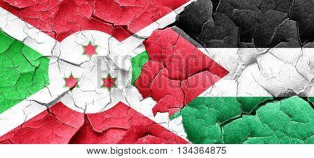 Burundi flag with Palestine flag on a grunge cracked wall