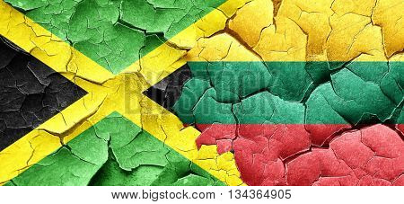 Jamaica flag with Lithuania flag on a grunge cracked wall