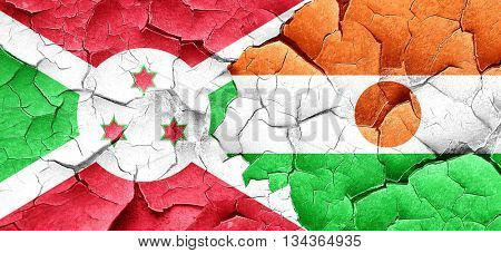 Burundi flag with Niger flag on a grunge cracked wall
