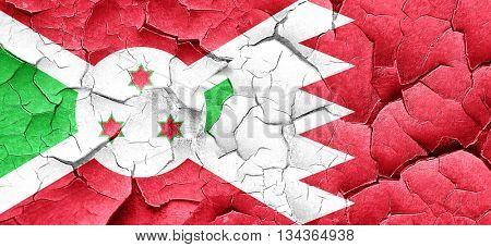 Burundi flag with Bahrain flag on a grunge cracked wall