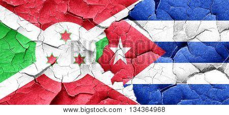Burundi flag with cuba flag on a grunge cracked wall