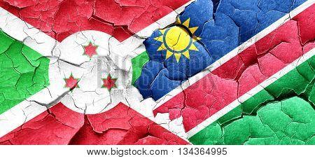 Burundi flag with Namibia flag on a grunge cracked wall