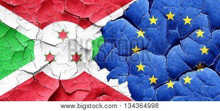 Burundi flag with european union flag on a grunge cracked wall