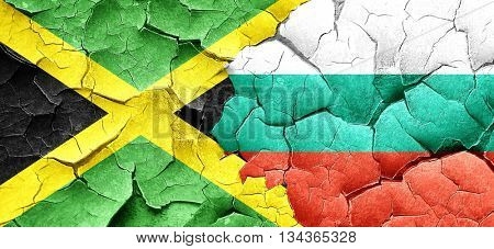 Jamaica flag with Bulgaria flag on a grunge cracked wall