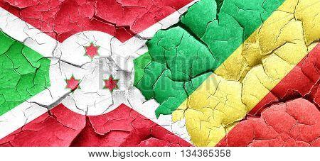 Burundi flag with congo flag on a grunge cracked wall