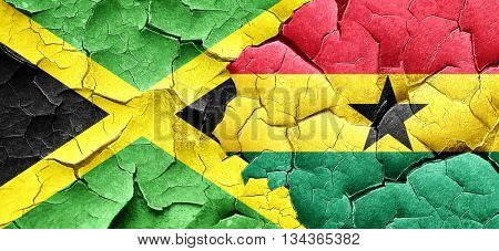 Jamaica flag with Ghana flag on a grunge cracked wall