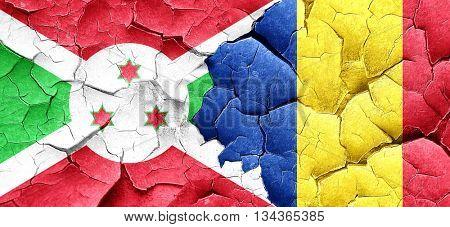 Burundi flag with Romania flag on a grunge cracked wall