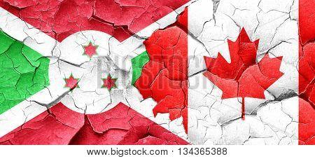 Burundi flag with Canada flag on a grunge cracked wall