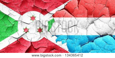 Burundi flag with Luxembourg flag on a grunge cracked wall