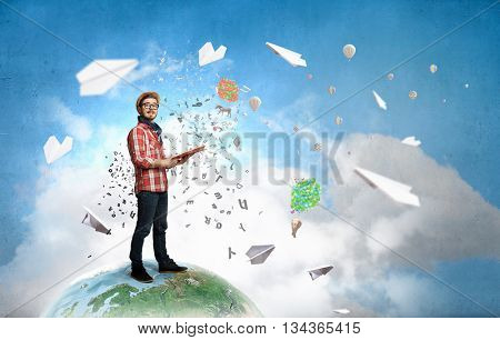 Hipster guy with book in hands