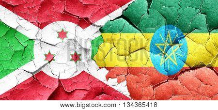 Burundi flag with Ethiopia flag on a grunge cracked wall