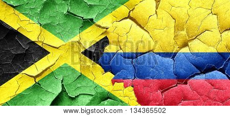 Jamaica flag with Colombia flag on a grunge cracked wall