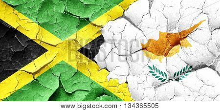 Jamaica flag with Cyprus flag on a grunge cracked wall