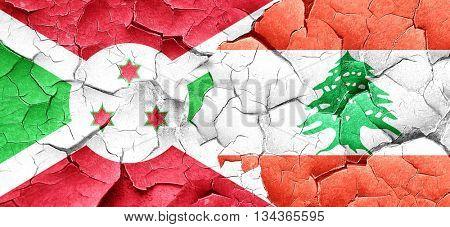 Burundi flag with Lebanon flag on a grunge cracked wall