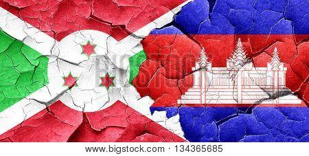 Burundi flag with Cambodia flag on a grunge cracked wall