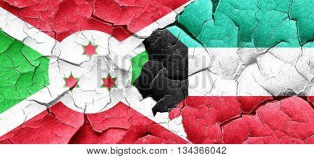 Burundi flag with Kuwait flag on a grunge cracked wall