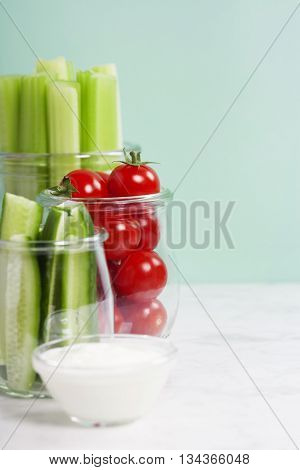 assorted fresh vegetables with dip on blue background - Vegan, Vegetarian, Healthy food